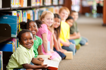 children in library smiling