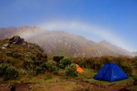 tent with rainbow in the distance